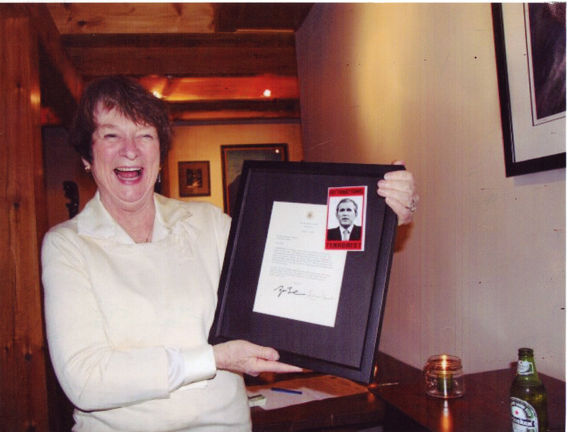 "In an undated photo released by the Maine Republican Party, Democratic candidate Libby Mitchell holds an image of President George W. Bush that labels him an ""international terrorist."" Mitchell has apologized for the photo's message."