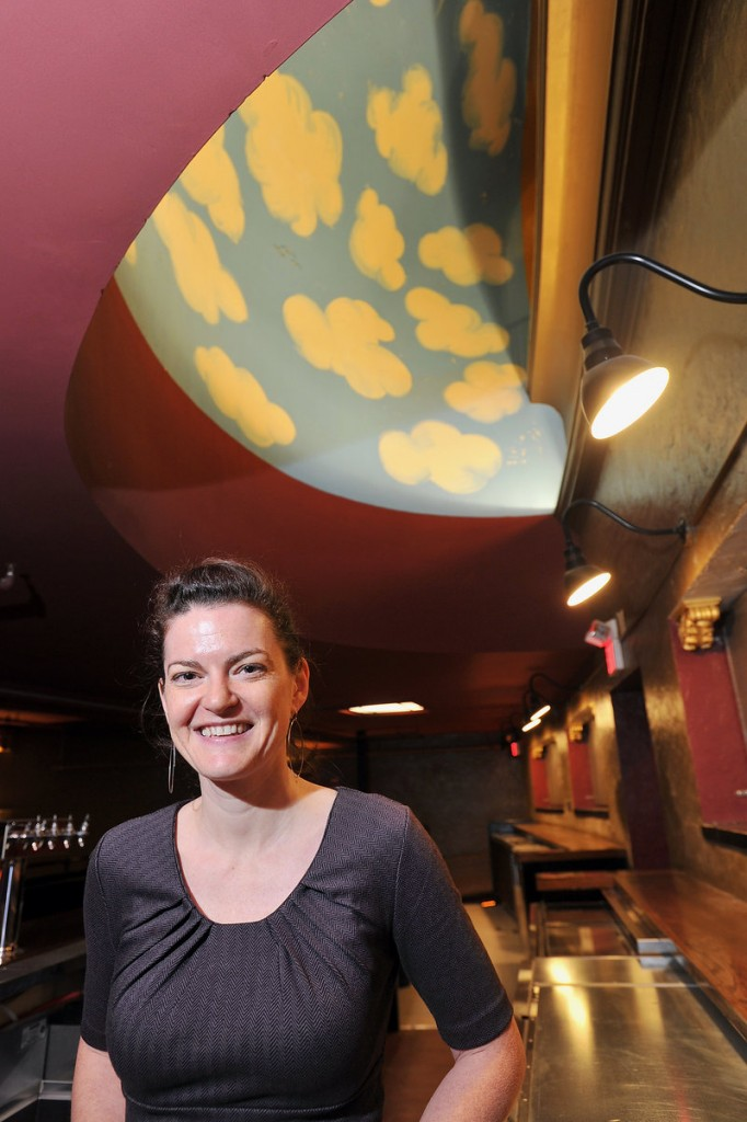 General manager Lauren Wayne stands in one of the venue's renovated bar areas. The theater reopens Friday night with a concert by My Morning Jacket.