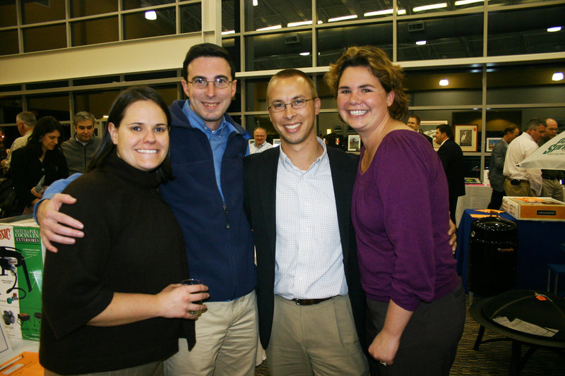 Chris Cameron and Aric Walton, who serve on the steering committee for STRIVE, with their wives Sarah Begin and Jess Walton.