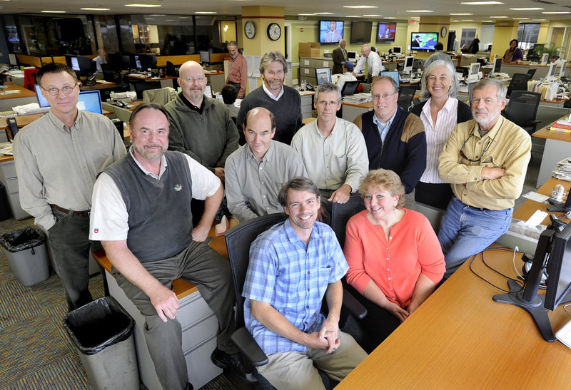 The Maine Press Association award winners from The Portland Press Herald/Maine Sunday Telegram include: seated from left, Gregory Rec and Sally Tyrrell; second row, Gordon Chibroski, David Hench, John Richardson, Mike Lowe, Julia McCue and John Ewing; and back row, Rick Wakely, Joe Grant and Bill Nemitz.