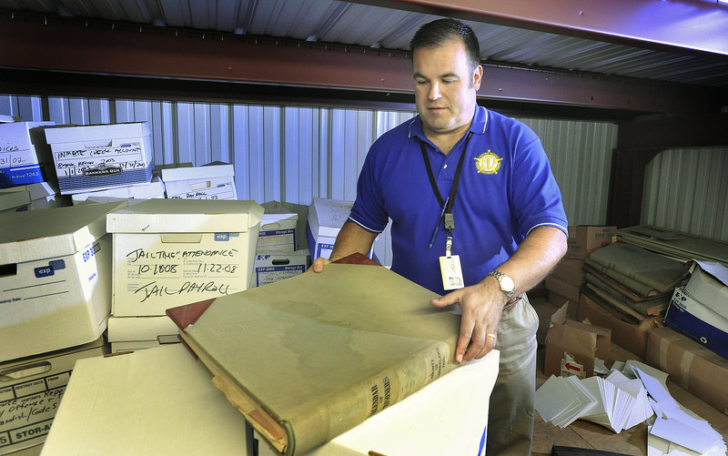John Ewing/Staff Photographer Capt. Dan Goulet of the Cumberland County Sheriff's Department is overseeing a project to move old files and records into a more rodent-free rental storage unit.