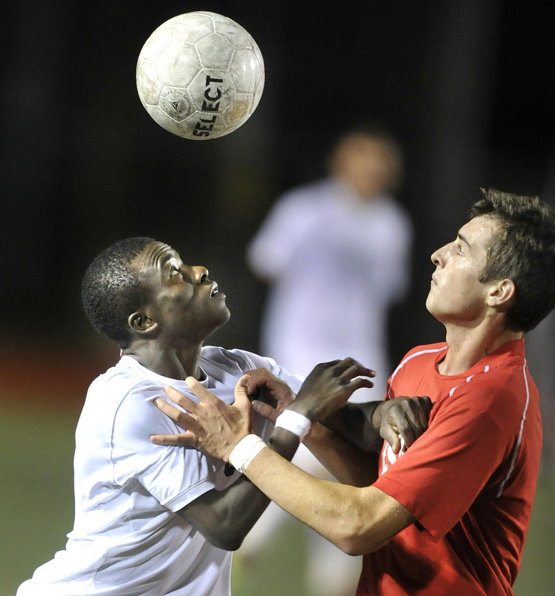 Tony Yekah, left, of Portland and Nemanja Kaurin of South Portland compete for the ball Thursday night during third-ranked Portland s 4-1 victory at Fitzpatrick Stadium.