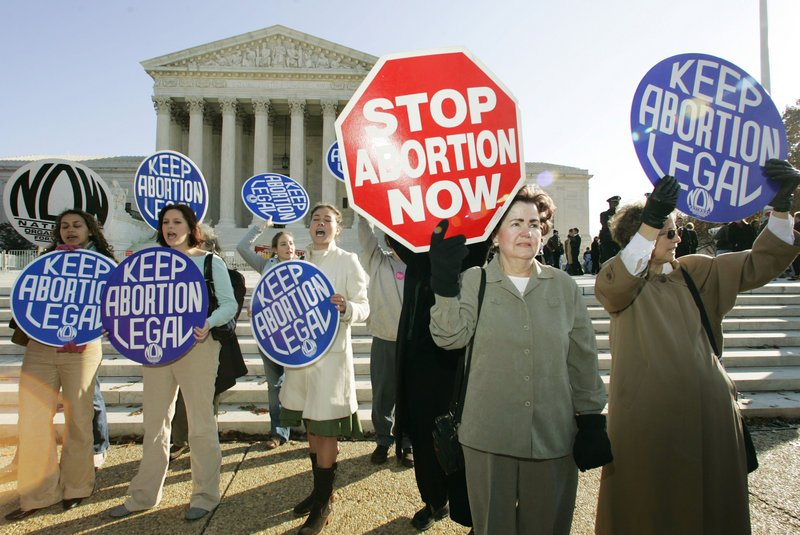 Abortion opponents and proponents stand outside of the U.S. Supreme Court in 2005 during the first abortion case to be decided with John Roberts as chief justice. Both sides of the abortion debate are lining up for a new round of debates, this time over the definition of when fetuses begin to feel pain.