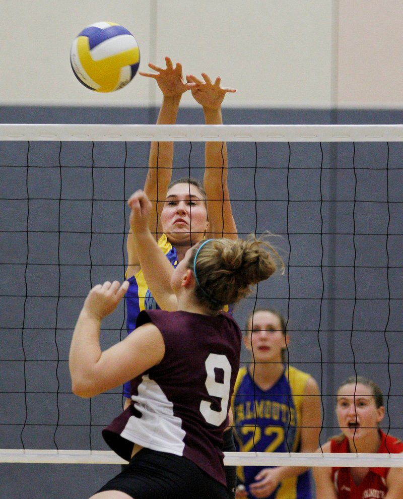 Nicole Rogers of Falmouth blocks a shot by Greely's Danielle Cimino. Falmouth finished the regular season 12-2.