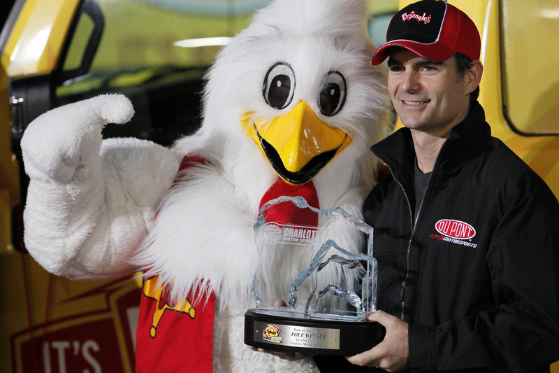 Jeff Gordon poses with the mascot for Bojangles, a Southern restaurant chain, after Gordon took the pole position for tonight's NASCAR race in North Carolina. Gordon has won five times at the track, but just once since 1999.
