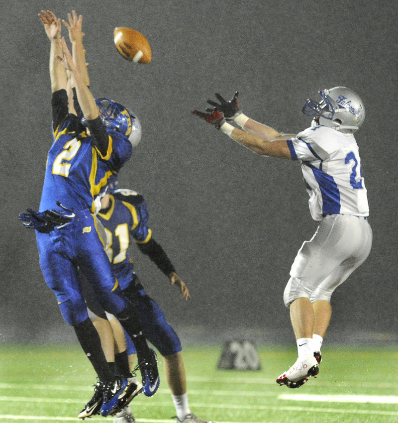 Matt Kingry, left, of Falmouth is unable to haul in a pass Friday night as Taylor Bradley of Mountain Valley goes for an interception during Mountain Valley's 38-0 victory.