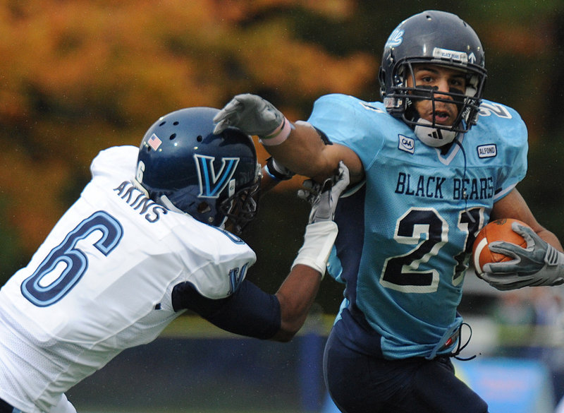 Maine running back Jared Turcotte tries to shrug off Villanova's Ronnie Akins on Saturday, but Turcotte had just 35 yards rushing on seven carries as Maine lost, 48-18.