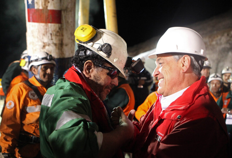 The last miner to be rescued, Luis Urzua, left, shakes hands with Chile s President Sebastian Pinera. The successful rescue of the miners has greatly enhanced Pinera s reputation.