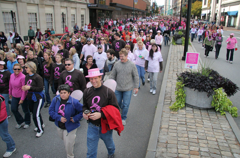 Teams of walkers filled Congress Street for the American Cancer Society's Making Strides Against Breast Cancer Walk in Portland on Sunday. The event benefits research, education and patient support efforts.