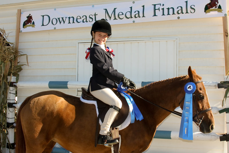 Magdalene Meek of Portland placed first in lead-line equitation and lead-line pleasure at the Downeast Medal Finals Horseshow.