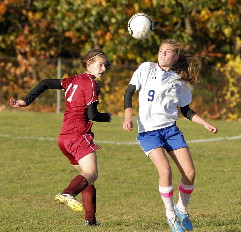 Olivia Dubois of Old Orchard Beach tries to control the ball as Richmond's Katie Webster closes in during Monday's game at Old Orchard Beach. OOB likely secured a Western Class C tournament berth with its 3-0 victory.