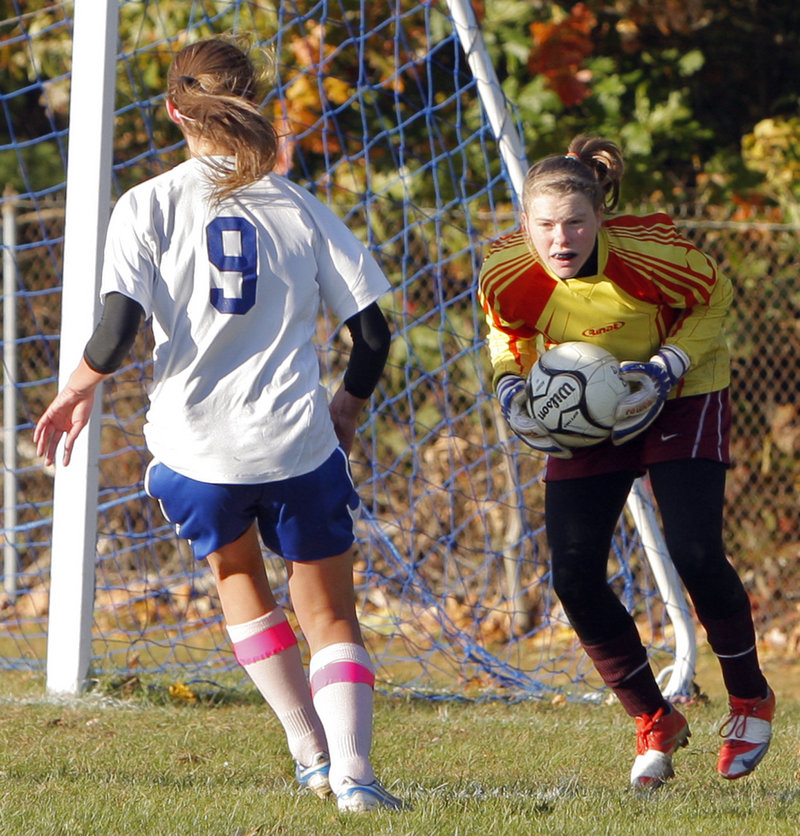 Lindsy Hoopingarner of Richmond scoops up the ball in front of Olivia Dubois of Old Orchard Beach during Monday's game at Old Orchard Beach. Richmond suffered its first loss, 3-0.