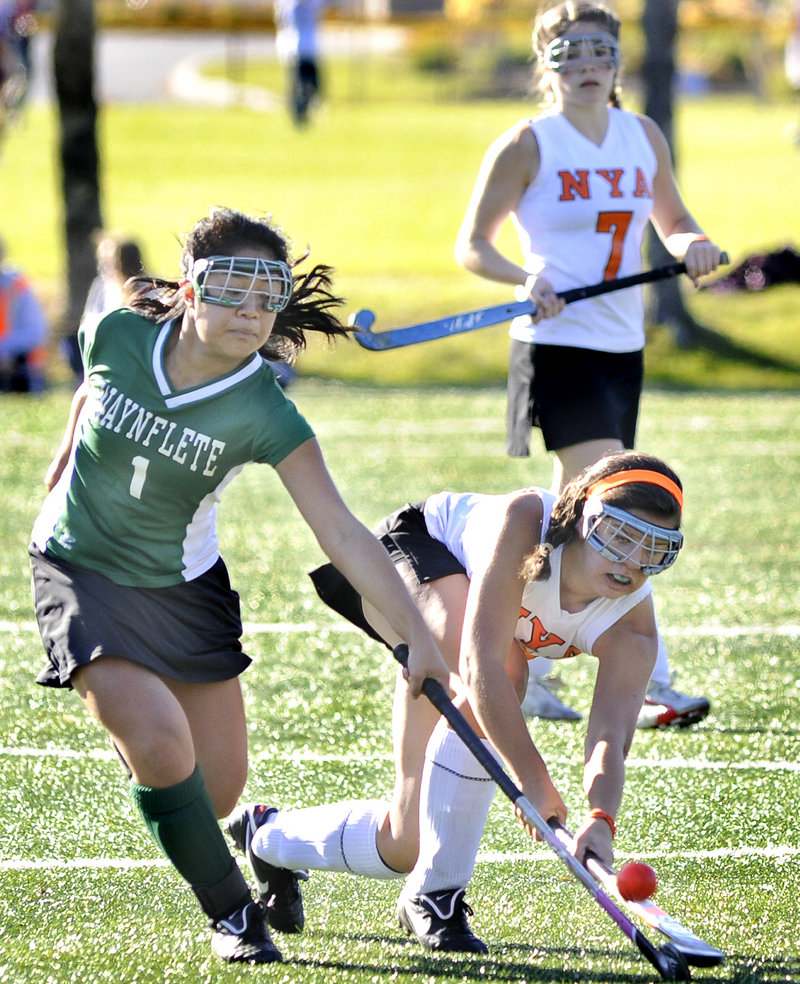 Roz Gray-Bauer of Waynflete, left, and Bailey Clock of North Yarmouth Academy fight for the ball Tuesday in Yarmouth. The Panthers took a 6-0 lead at halftime.