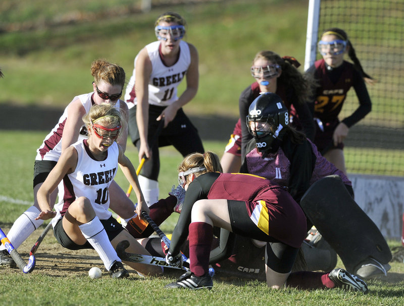 Jessica Wilson of Greely, 10, has her scoring bid knocked away by the Cape Elizabeth defense Tuesday as the ball pops loose. Third-ranked Greely advanced to the Western Class B semifinals with a 4-3 victory at home.