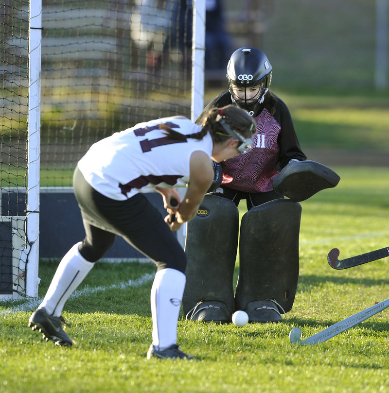 Cape Elizabeth goalie Piper Otterbein stands her ground to stop a scoring bid by Sarah Howard of Greely in the second half.