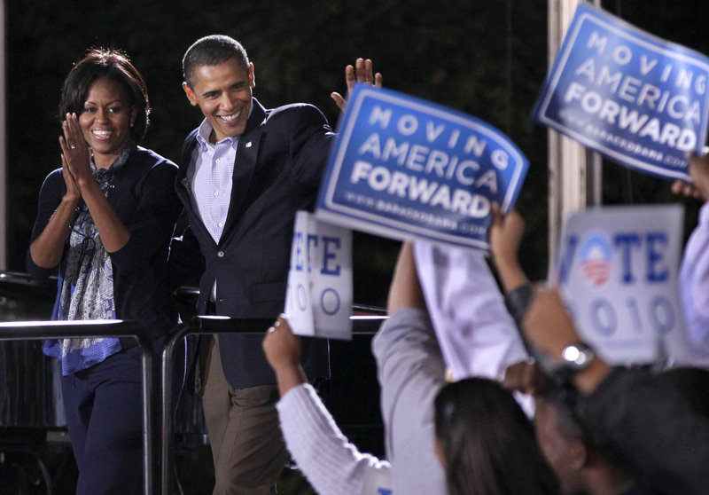 President Obama and first lady Michelle Obama muster support for Democratic candidates during a rally Oct. 17 at Ohio State University in Columbus, Ohio. In the latest Associated Press-GfK poll, responses to almost every question pointed to Republican gains on Election Day. Fifty-nine percent of respondents said they think the nation is headed in the wrong direction, and only 45 percent approved of how Obama is doing his job.