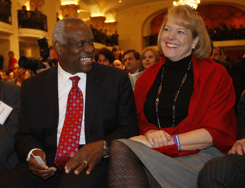 Supreme Court Justice Clarence Thomas sits with his wife Virginia Thomas at an event in Washington in 2007. Those who know Virginia Thomas say she has never gotten over the 1991 controversy that turned Clarence Thomas' confirmation hearings into a national sensation.