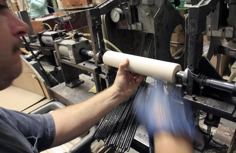 """When Scott Allen heard the Saunders Bros. manufacturing plant in Greenwood was closing last spring, """"I thought that was it,"""" he says. Now he's back at work, shown here assembling rolling pins at the reopened plant."""
