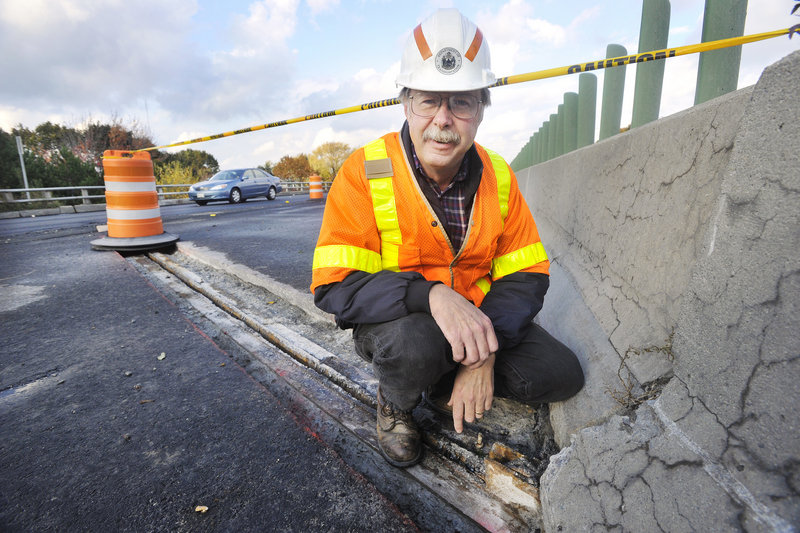 David Lycette of the Maine Department of Transportation shows the work being done on an I-295 overpass in Portland. Some projects will be extended to next summer as several bridges needed more repair than anticipated, but most roadwork will be finished by mid-November.
