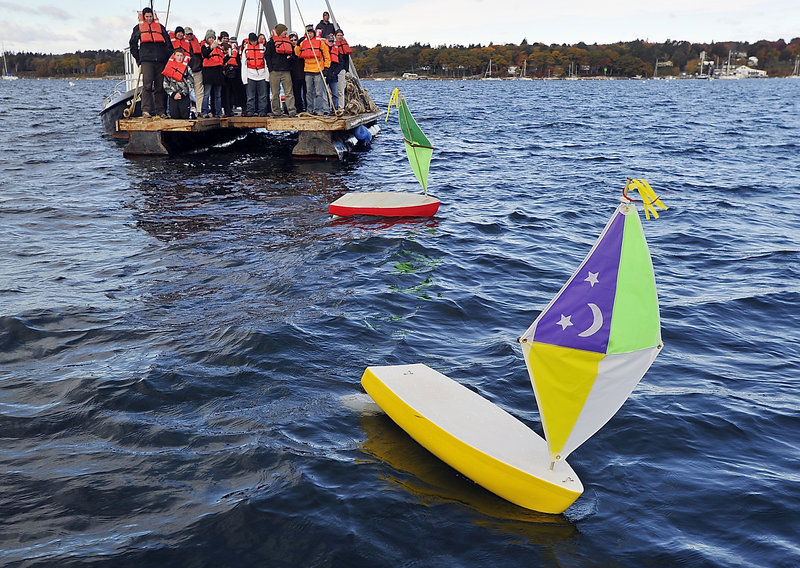 Students from the Compass Project in Gorham test two 5-foot handmade sailboats near Handy Boat in Falmouth on Friday. High school students in the Compass Project's boat-building program are preparing for a trans-Atlantic race of four unmanned, GPS-tracked mini-sailboats, competing against vessels from Belfast, Searsport and Mount Desert Island. The boats will be carried on a freighter leaving Searsport in early November, taken to a location in the Caribbean, then launched into the Gulf Stream. The first boat to get within 100 miles of Europe is the winner.