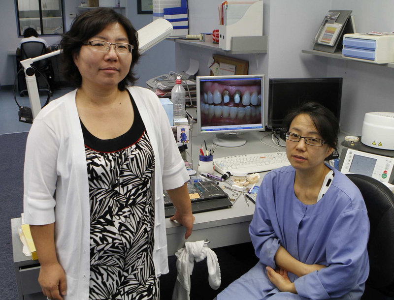 A pair of sisters, Janet, left, and Kay Lee, run a dental laboratory in Los Angeles. They are borrowing $17,000 through the Small Business Administration to pay company debts and hire a part-time technician to make crowns and bridges.