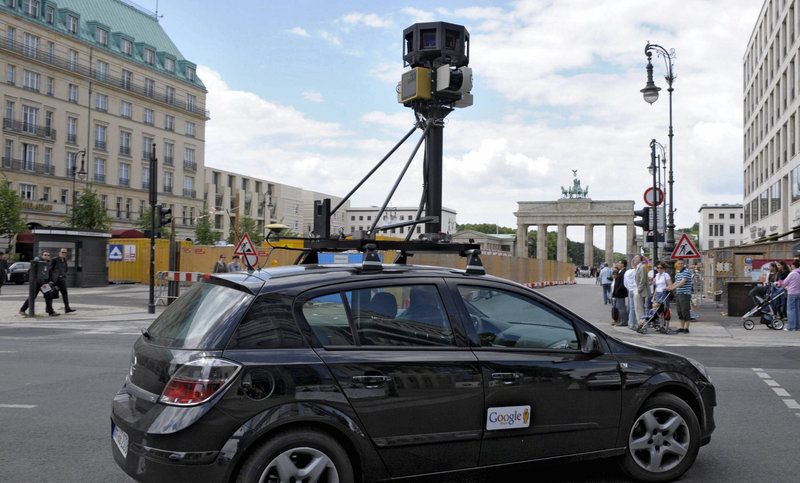 A Google mapping car records street views in Berlin. The use of such vehicles to also log locations of Wi-Fi networks has sparked privacy concerns.