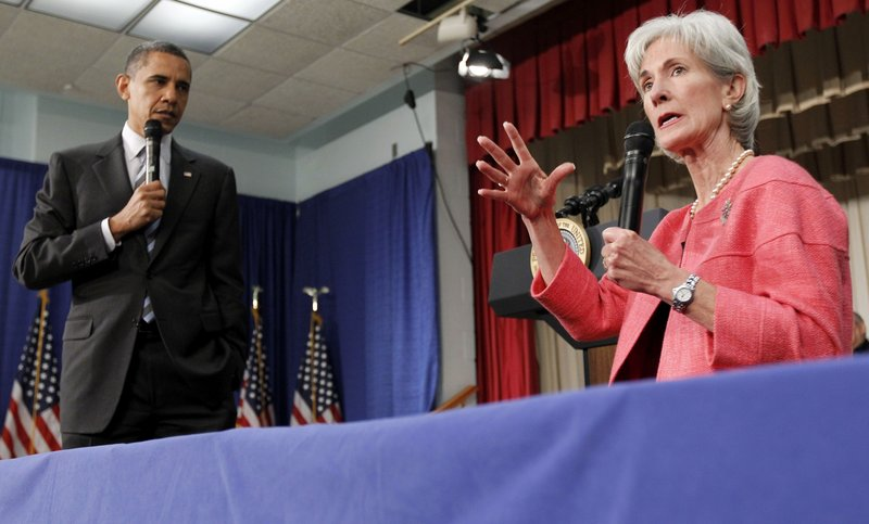 President Barack Obama listens as Health and Human Services Secretary Kathleen Sebelius speaks in Wheaton, Md., on June 8. During the health care reform process, insurers backed Democrats and got what they wanted: a federal mandate that most Americans carry health care coverage.