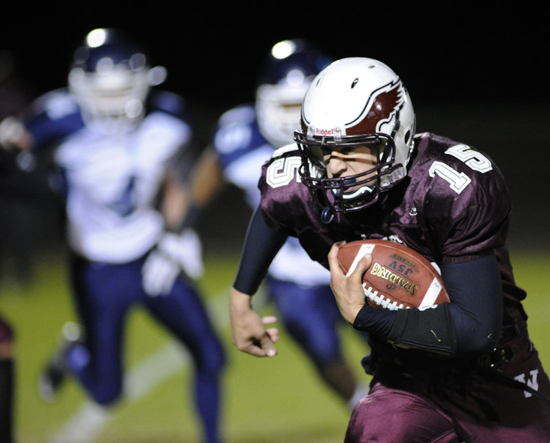 Windham quarterback Cody Laberge looks for running room as he picks up some of his team-high 169 rushing yards Friday night in a 29-8 victory over Westbrook at Windham.