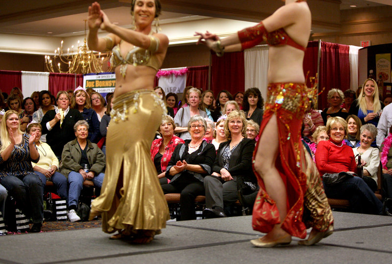 Belly dancers Emma Holder, left, and Rosa Noreen perform during the A Dash of Diva: Girls' Night Out in Portland. A portion of the event's proceeds will be donated to the Maine Women's Fund and the Press for Higher Education Scholarship Fund.
