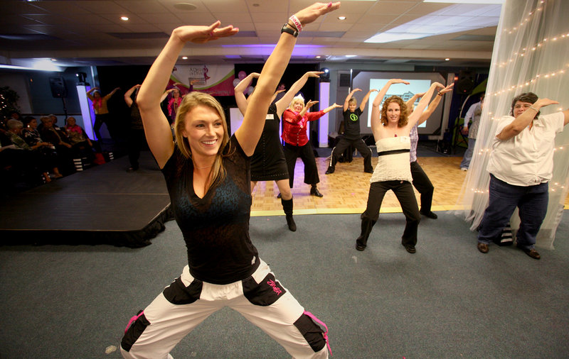 Zumba instructor Ashley Marble leads a dance fitness session at A Dash of Diva at Holiday Inn by the Bay in Portland on Friday.