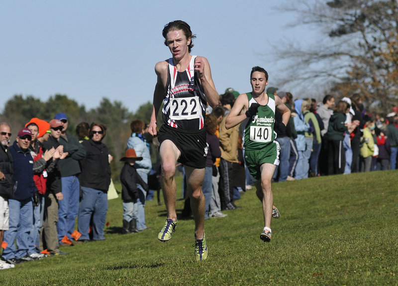 Nick Morris of Scarborough is on his way to victory over Jakob Brooks during the cross country regionals in Cumberland on Saturday. Morris won the Class A race in 16:59.30.