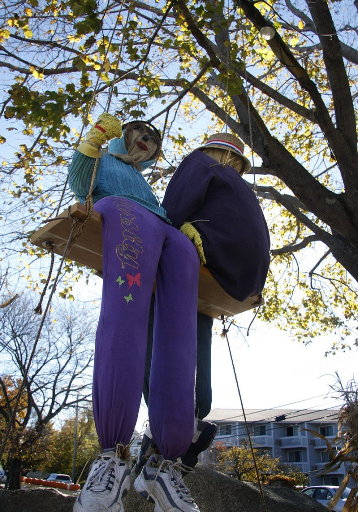 A pair of scarecrows swings in front of Anchorage by the Sea.