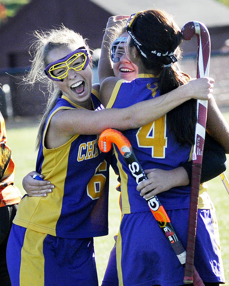 It was celebration time Saturday for the Cheverus field hockey team after the 2-1 victory against Scarborough in the Western Class A semifinals. From left to right are Catie Walsh, Annie DiLisio and Gabi Cardona. The Stags will meet Bonny Eagle for the title.