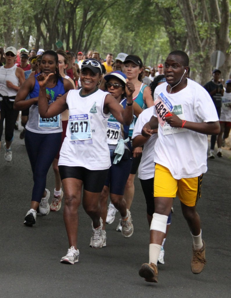 Orah Bessit, 66, left, participates in a road race in Johannesburg in September. Bessit, who grows her own vegetables, walks and runs, has given up hamburgers and switched from white to whole-grain bread.