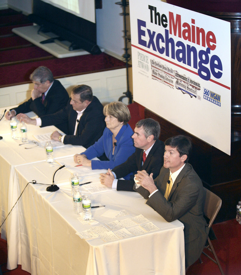 Kevin Scott answers a question Saturday night during The Maine Exchange gubernatorial debate at the First Parish Unitarian Church in Portland. Candidates stuck with familiar themes a little more than a week before Election Day.