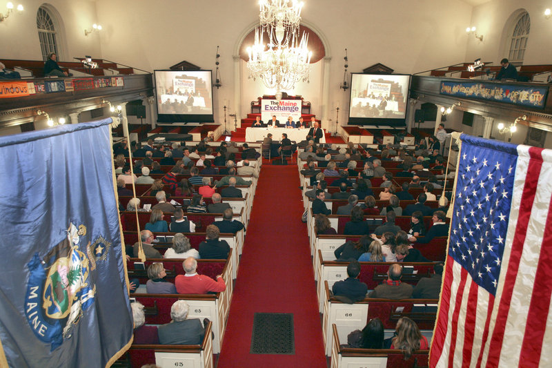 A packed house watches The Maine Exchange debate Saturday, which focused on education, energy and economic issues.