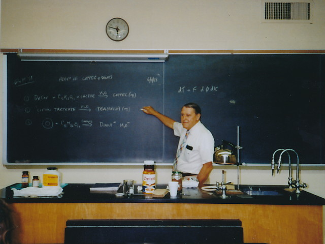 Family photo Walter Bunce Spencer Jr. teaches at a blackboard in 1979 during his tenure as a science teacher.