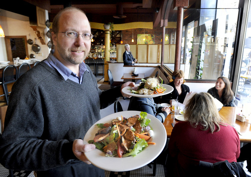 Reporter Ray Routhier has his hands full as he works waiting tables at David's restaurant in Portland.