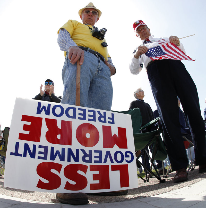 Dave Willett, left, and Tom Shea take part in a tea party rally in Buffalo, N.Y., in April. Research by The Washington Post showed the group to be a disparate band of vaguely connected gatherings that do surprisingly little to engage in the political process.