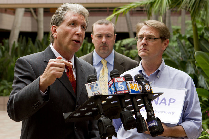 Attorney Irwin Zalkin, left, alongside David Clohessy, right, national director of the Survivors' Network of those Abused by Priests, and attorney Anthony DeMarco, speaks Sunday in San Diego after the release of previously sealed church documents that detail sexual abuse complaints against priests.