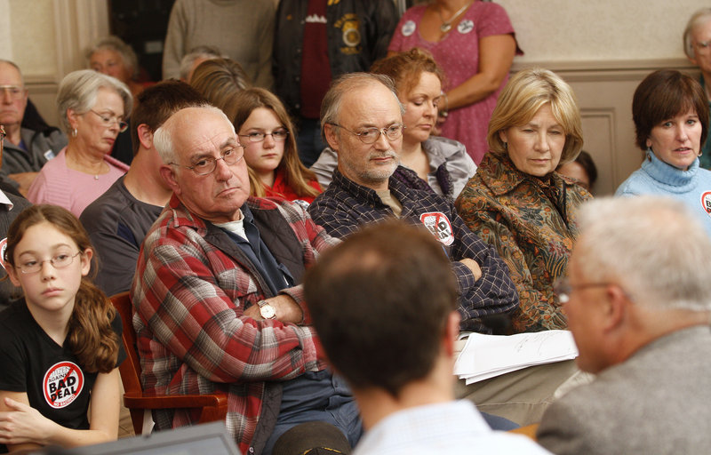 Racino supporters and opponents listen to speakers from the opposition discuss the proposal for Biddeford Downs, a racino and entertainment/hotel complex in Biddeford, at Monday night's meeting in the City Council chambers.