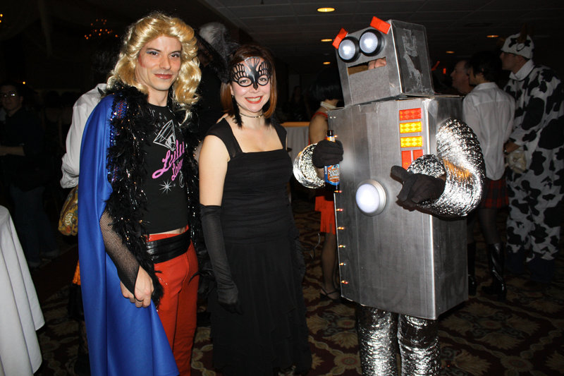 "Joel Marquis, who won the award for Best Goodwill Find dressed as the lead from ""Hedwig and the Angry Inch,"" Carol Hammond, dressed as a raven, and Nate Butler, dressed as a robot"