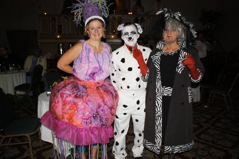 Tammie Keslake, who won the Best Overall award dressed as a jellyfish, Frank DiBiase, dressed as Pongo the Dalmatian, and Gail DiBiase, dressed as Cruella de Vil.