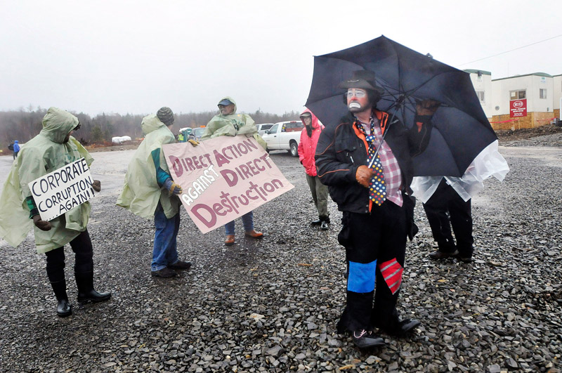 Protesters outside Rollins wind energy project in Lincoln Monday, Nov. 8, 2010 including Don Thomas of Lincoln who dressed as a clown named Scruffy. Thomas was with Friends of Lincoln Lakes.