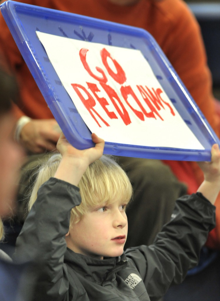 Darius Rieger, 9, of Cape Elizabeth, brought his own sign to support the Red Claws in their season opener at the Portland Expo.