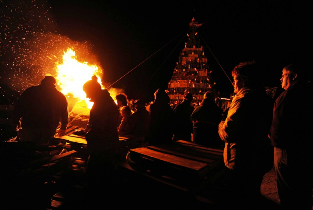 People gather on Beals Island Sunday to watch the lighting of a Christmas tree constructed of lobster traps and buoys.