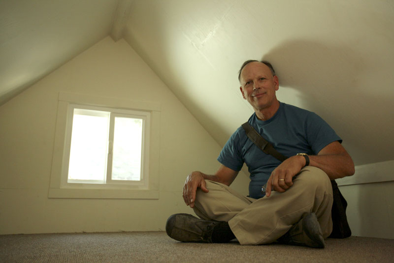 Stephen Marshall, owner of Little House on the Trailer, in the loft of one of his small houses in Petaluma, Calif.