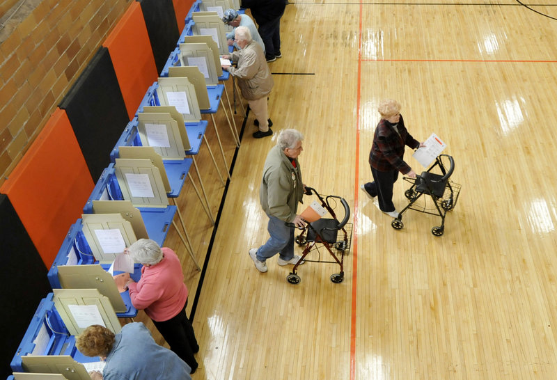 A pair of voters in Biddeford walk away from voting booths at the J. Richard Martin Community Center in Biddeford on Tuesday, Despite its being an off-year election, many areas reported a heavy turnout of voters.