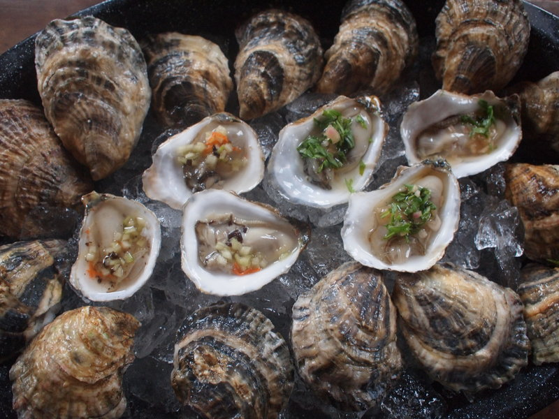 Kayli Lee, owner of WaldoStone Farm in Montville, has developed five new oyster mignonettes she hopes to begin selling in Portland this holiday season. The oysters on the left are topped with her seaweed cucumber mignonette, and the oysters on the right are dressed with her champagne tarragon mignonette.