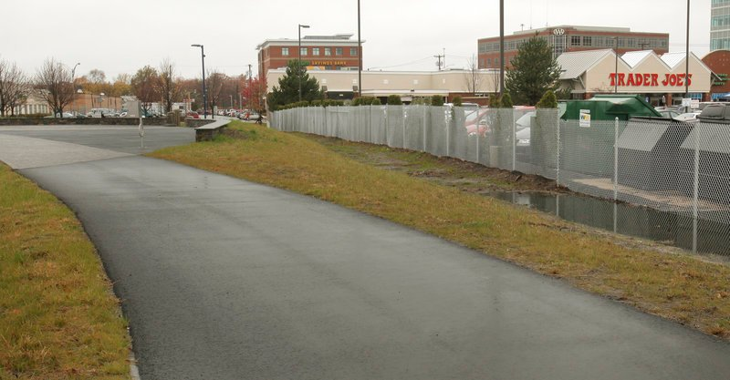 The fence separating the Trader Joe's parking lot from the Bayside Trail has generated complaints from trail users who want pedestrian and bicycle access to the store.